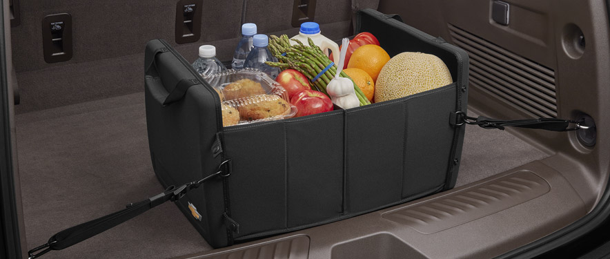 GM cargo organizer full of groceries inside a trunk
