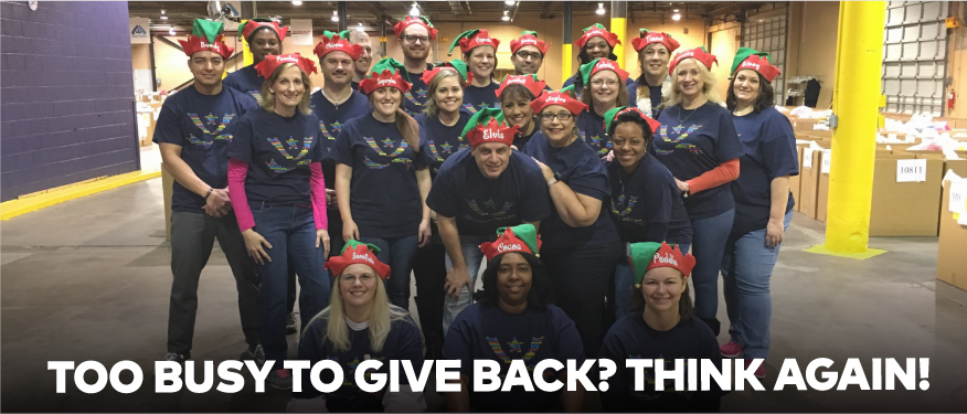 "Group of GMF employees volunteering at Salvation Army with text overlay, ""Too busy to give back? Think again!"""