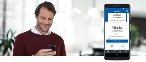 man smiling while using his phone, cell phone showing MyAccount screen.