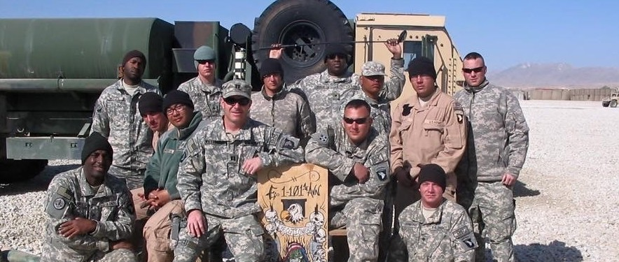 Tod Willoughby (seated front, center) with his artillery platoon in Afghanistan.